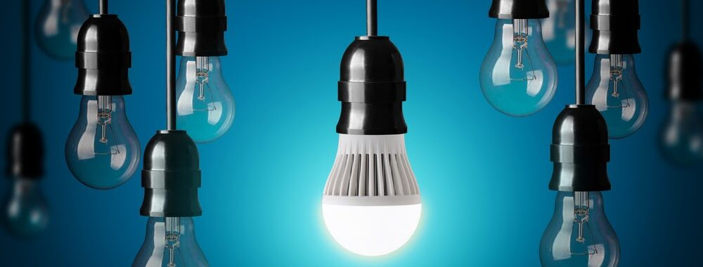 hanging LED bulbs against blue background